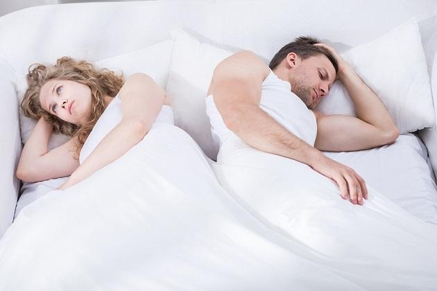 Couple In Crisis Lying In Bed