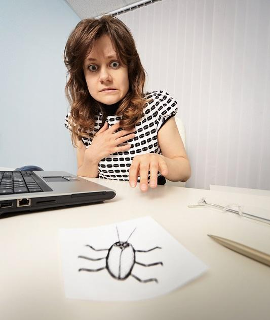 Woman Scared With Paper Cockroach