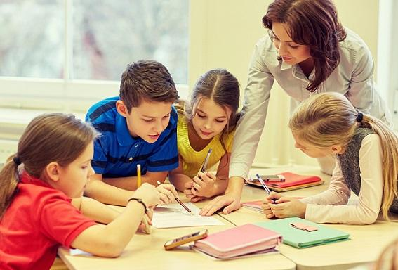 education, elementary school, learning and people concept - teac